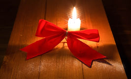 Red festive decorative bow on light brown wooden boards Stock Image