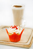 Red festive muffin and coffee Latte in a glass Stock Photos
