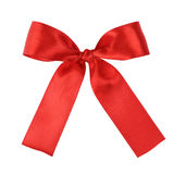 Red festive tied bow made from ribbon Stock Image