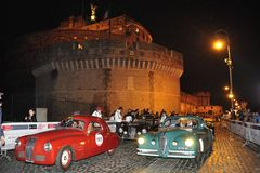 A red Fiat 1100 and a green Alfa Romeo 6C 2500 SS Coupe' Touring Royalty Free Stock Photos