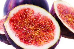 Red fig. The fresh fig of red color cut on some parts (a background white Stock Image