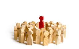 Red figure leader stands at the head of the crowd. Business concept of leader and leadership. Qualities stock photo