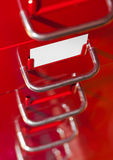 Red file cabinet with blank card. Business background Stock Photo