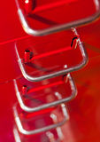 Red file cabinet with drawers Stock Image