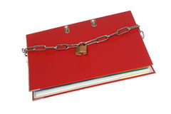 Red file folder with chain Stock Images