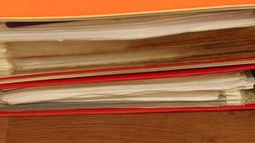 Red file folders, ring binders on office table, full HD. Paperwork. Red file folders, ring binders on office table. Full HD with motorized slider. 1080p stock video footage