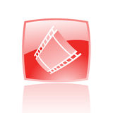 Red film. Reel in red glass button isolated on white Royalty Free Stock Photos