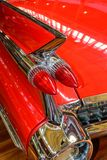 Red Fin of the legendary Cadillac Coupe de Ville. Elegant red Fin of the legendary Cadillac Coupe de Ville stock photography