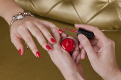 Red finger nails in a cosmetic center manicure Royalty Free Stock Photos