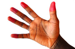 Red finger tips. This is an image of a black hand with red coloured finger tips stock photo