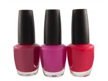 Red fingernail polish bottles Royalty Free Stock Photos