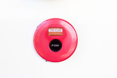 Red fire alarm bell on wall Stock Photos