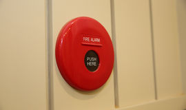 Red fire alarm bell on wood wall Stock Photography