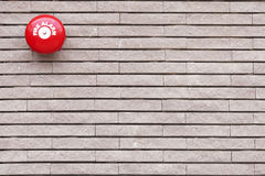 Red Fire Alarm on brick wall Stock Photo