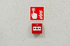 Red fire alarm button Royalty Free Stock Photo