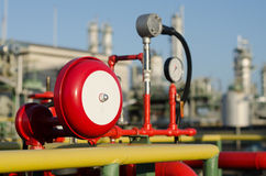 Red fire alarm and petrochemical plant Stock Photography