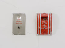 Red fire alarm pull station on wall Stock Images
