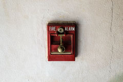 Red fire alarm setup on white wall. Royalty Free Stock Image