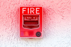 Red fire alarm switch. At cement wall Royalty Free Stock Photo