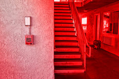 Red fire alarm switch at cement wall Royalty Free Stock Image