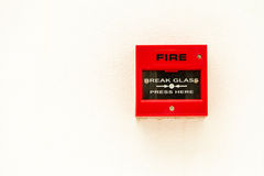Red fire alarm. Switch on white concreat wall stock images