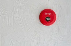 Red Fire alarm on white wall Stock Photos