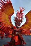 Red fire bird one. A man wearing phoenix or fire bird costum in Jember Fashion Carnival 13 th on august 2014 at jember , east java, indonesia stock photo