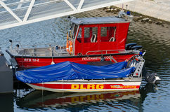 Red fire boat in port. Fire rescue boat is in port Royalty Free Stock Photos
