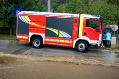 Fire department rushes to rescue when floods hit village in Europe after heavy rain Royalty Free Stock Photography
