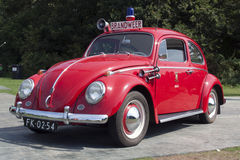Red fire brigade volkswagen beatle Stock Images