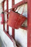 Red fire bucket on the wall Stock Image
