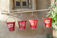 Red fire buckets filled with sand Royalty Free Stock Photography