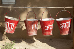 Red fire buckets filled with sand Stock Photo