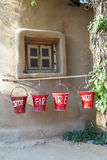 Red fire buckets filled with sand Stock Images