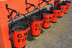 Red fire buckets, Hampton Loade. Royalty Free Stock Photography