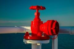 Red fire cock, fireplug on a ship Stock Photography