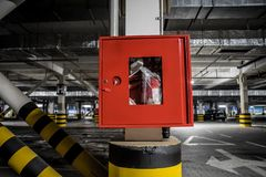 Red fire crane at underground parking stock image