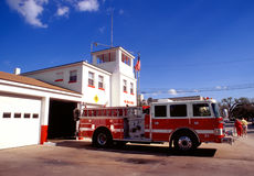 Red Fire Engine. And station on a summer day Royalty Free Stock Photo