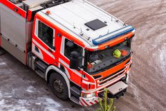 Red fire engine in a yard. Finland Royalty Free Stock Photos