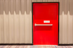 Red fire exit door royalty free stock image