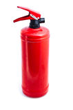 Red fire extinguisher. On white background royalty free stock image