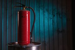Red fire extinguisher on metal background Royalty Free Stock Photos