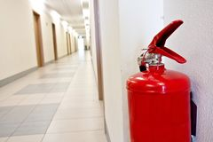 Red Fire extinguisher in the corridor. Safety concept Royalty Free Stock Photos