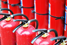 Red fire extinguishers. Closeup of red fire extinguishers in line Stock Photography
