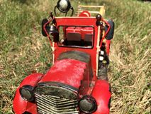 Red fire fighter vintage  in grass Stock Photography