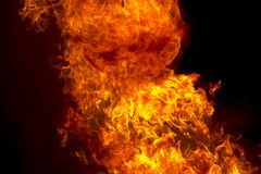 Red fire flame on black background Royalty Free Stock Photos