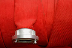 Red fire hose royalty free stock photography