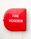 Red fire hose box Stock Photography