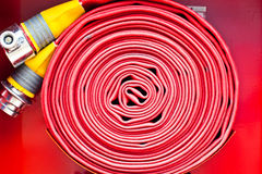 Red Fire Hose coil Royalty Free Stock Images