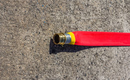 RED FIRE HOSE Stock Photo